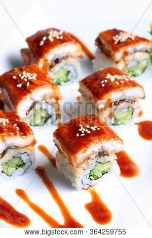 Dragon Rolls Or Sea Eel Rolls Cream Cheese And Avocado Inside. Topped With Smoked Eel (unagi)