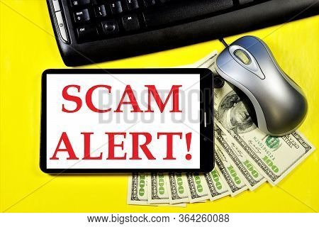 Scam Alert-a Message On The Tablet Computer Screen. Fraud Is Theft Or Acquisition Of The Right To An