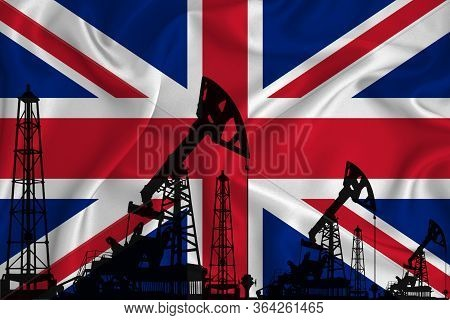 Silhouette Of Drilling Rigs And Oil Derricks On The Background Of The Flag Of Great Britain. Oil And