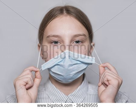 Teenager Girl 12-15 Years Old, Removes Medical Mask From Her Face, Recovered Changes Mask To New One