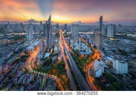 Amazing Beautiful View Of Midtown Bangkok City Skyline And Skyscraper At Sunset.