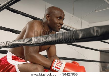 Boxer resting while end of a round in the match