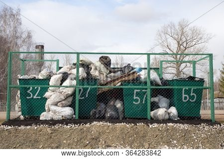 Ishimbay, Russia - April 13, 2020: Overflowing Garbage Cans In The Countryside. Ecology.