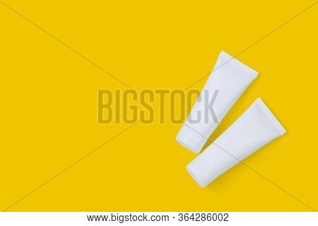 Cosmetic Tube Isolated On Yellow Background, Mockup Package Of Lotion Or Cream, Product Beauty And M