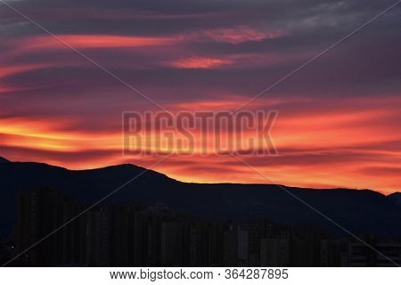 Morning Sky Over The Roofs. Sunrise. Urban Landscape. Dawn. Daybreak. Sunset/ Dark Beautiful Sunset