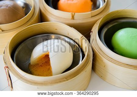 Chinese Salted Egg Bao (bun), Yolk Flowing Out Of Chinese Bun Steamed Bun.