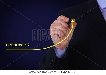 Businessman Draws Growing Line Symbolizing Growing Resources