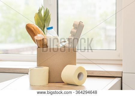 Donation Box With Food On A Light Interior Background.