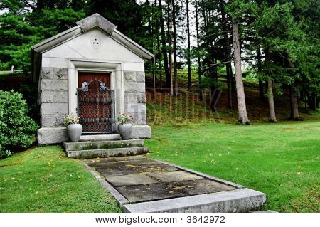A Crypt In A Grassy Spot