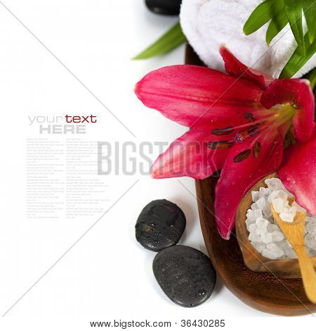 Spa concept (flowers, towel, sea salt and massage stones) (with easy removable sample text)