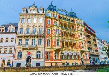 Karlovy Vary, Czech Republic, May 11, 2019: Quisisana Palace Hotel Building And Tepla River Embankme