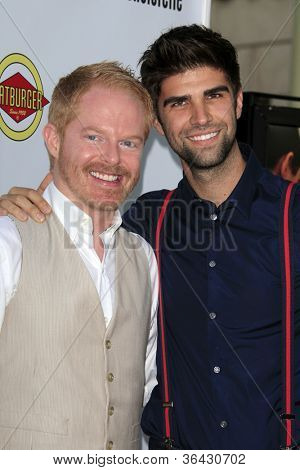 LOS ANGELES - AUG 23:  Jesse Tyler Ferguson, Justin Mikita arrives at the