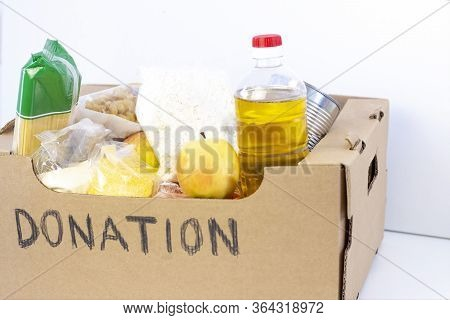 Donation. Grocery Box, Help Products For Those Who Need It. Donation Box. Cardboard Box With The Ins