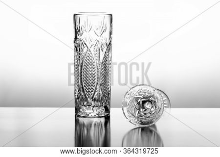 Empty Crystal Glasses Isolated On White Background..