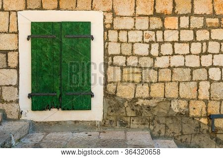 Authentic, Stone Wall, With Beautiful Green, Old, Wooden Shutters And Window, Background.