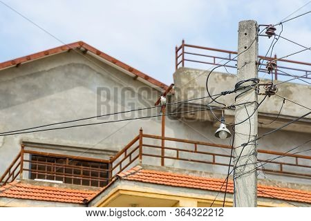 Beautifull Red-whiskered Bulbul Bird Singing In Melodious Voice While Sitting On The Wire Outdoors.