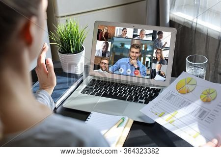 Business Woman Talking To Her Colleagues In Video Conference. Multiethnic Business Team Working From