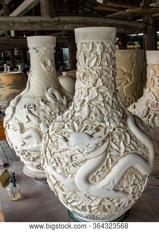 Pottery Vases Decorated With Carved Dragon Drying In A Pottery Workshop In Jingdezhen, Jiangxi Provi