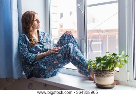 Young Red-haired Woman Relaxing At Home. Quarantine, Isolation, Coronavirus Pandemic World. Stay At
