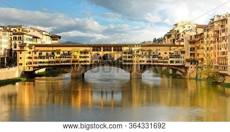 Panorama view of Ponte Vecchio over Arno river in Florence, Italy.
