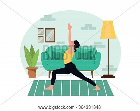 Young Beautiful Slender Girl Practices Yoga At Home In The Living Room During Quarantine. Healthy Li