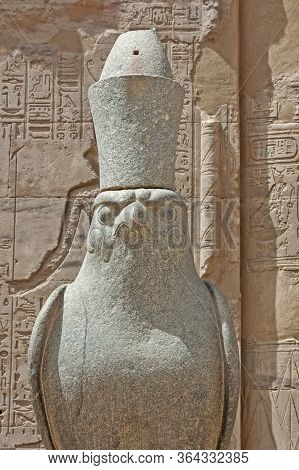 Ancient Egyptian Temple Of Horus In Edfu With Closeup Of Giant Statue And Hieroglyphics