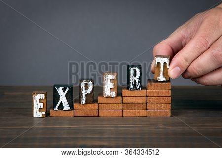 Expert Concept. Wooden Alphabet Letters On Steps