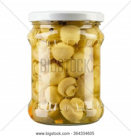 Delicious Marinated Mushrooms In The Glass Jar Isolated On White. File Contains Clipping Path.