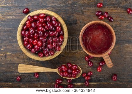 Dogwood Berries Drink And Fresh Dogwood In A Wooden Plate On A Wooden Background