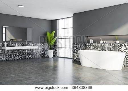 Corner Of Modern Bathroom With Grey Mosaic Walls, Concrete Floor, Window With Blurry Cityscape, Comf