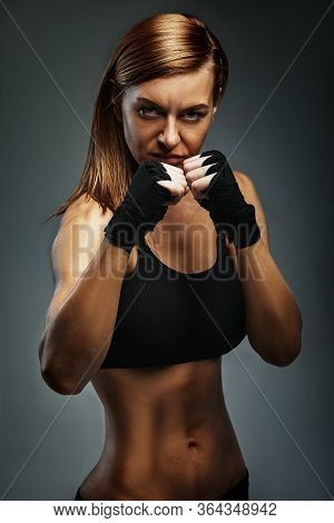 Female Boxer Piercing Gaze, Confident In Boxer Stance. Achieving A Goal, Boxing, Advertising Banner,