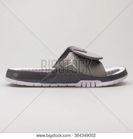 Vienna, Austria - February 19, 2018: Nike Jordan Hydro 11 Retro Grey And White Sandal On White Backg