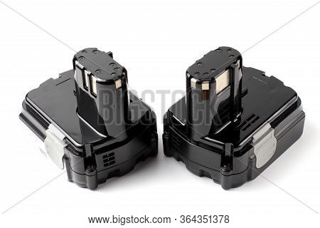 Lithium Batteries For Hand Tools Or Household Appliances. White Background, Close-up,