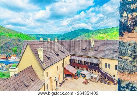 Courtyard Of Medieval Loket Castle Hrad Loket Gothic Style Building On Massive Rock With Green Fores