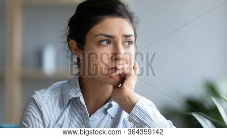 Head Shot Close Up Sad Young Indian Woman Thinking Of Problems.