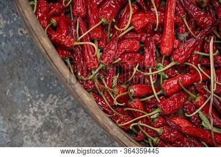 Chillies Drying In A Large Round Wicker Bowl In A Cellar Basement Of An Old House In A Small Mountai
