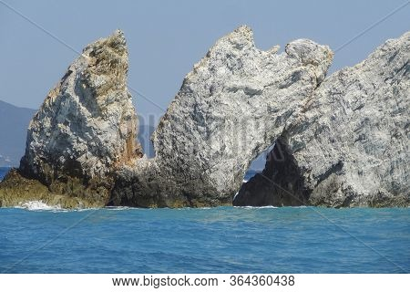 Sunny Rock Formation Around Lalaria Beach In Skiathos, One Of The Greek Sporades Islands