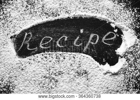 Headline Recipe Sprinkle Flour On A Black Table. Banner Recipe Handwritten Word.