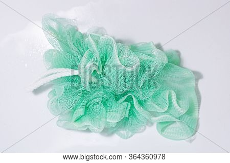 Mesh Synthetic Green Body Washcloth On A White Background