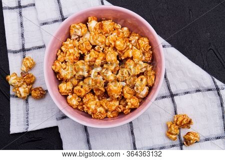 Close-up Golden Fried Popcorn In Ceramic Plate On Checkered Background. From Top View. Concept Of Ho