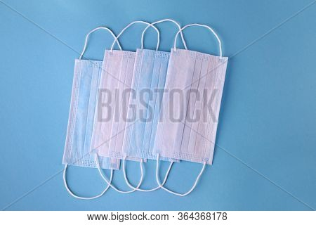 Medical Mask, Medical Protective Masks On Blue Background. Coronovirus Covid-19 Protective. Disposab