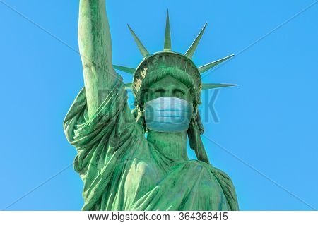 Close Up Of Statue Of Liberty With Surgical Mask, Symbol Of New York City At Time Of Covid-19 Isolat
