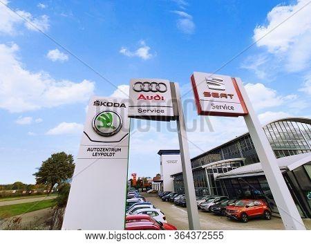 Filderstadt, Germany - October 03, 2019: Audi, Skoda, Seat Brand /emblem In Front Of Car Dealer / Wo