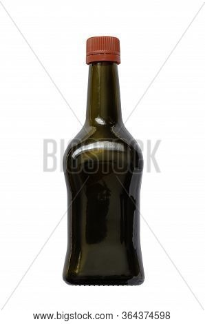Brown Glass Bottle With Red Cork. Square Bottle For Liquids, Sauce Or Marinades. Isolate On A White