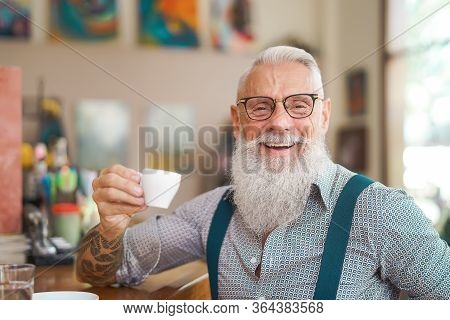 Happy Smiling Senior Man Drinking Coffee In Bar Restaurant - Hipster Trendy Older Male Portrait - Li