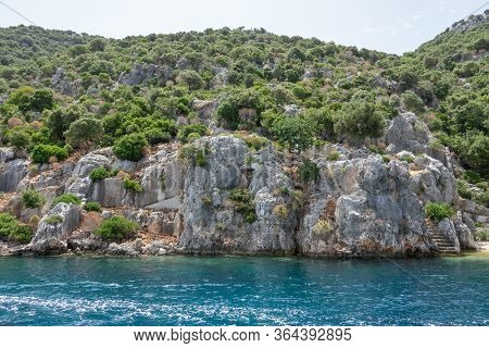 Ruins Of Sunken Ancient City Of Dolichiste On The Northern Part Of The Kekova Island. Devastating Ea