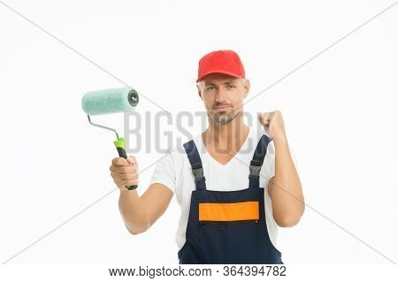 Paint Entire Room Or Just Accent Wall. Renewal And Redecorating. Professional Equipment. Mature Man