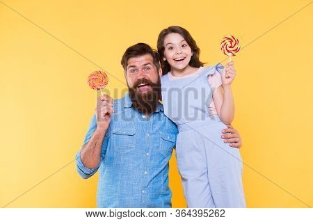 Loving Daddy And Small Girl Eating Lollipop. Summer Vacation. Happy Holidays. Sweet Childhood. When