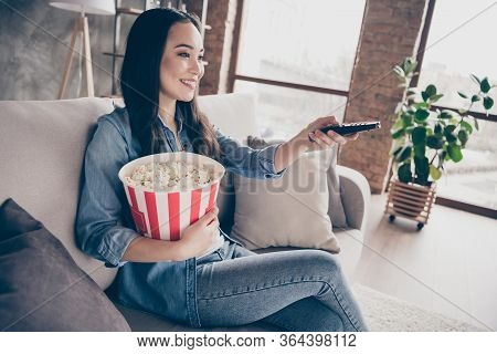 Profile Side Photo Of Charming Candid Girl Sit Divan Hold Big Pop Corn Box Take Remote Control Searc