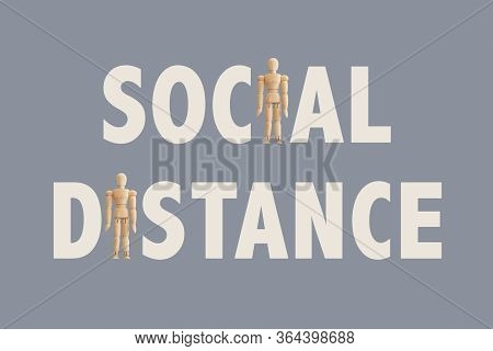 Social Distance Text, Including Wooden Human Figures. Message To Promote Preventive Distancing To Av